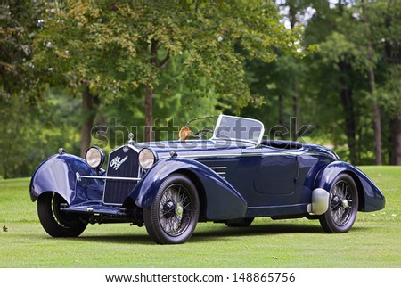 PLYMOUTH - JULY 28: A 1934 Alfa Romeo 8c 2300 Boat Tail Speedster owned by Roger Willbanks wins the Best of Show European Class at the 2013 Concours D'Elegance  July 28, 2013 Plymouth, Michigan.