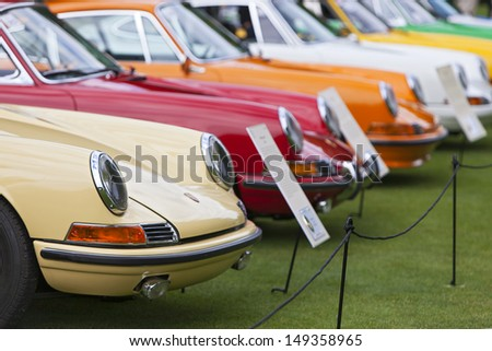 PLYMOUTH - JULY 28 : A row of Porsches on display at the Concours D'Elegance  July 28, 2013 in Plymouth, Michigan.