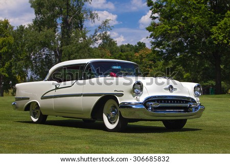 PLYMOUTH - JULY 26: A vintage Oldsmobile Holiday on display July 26, 2015 at the Councors D'Elegance in Plymouth, Michigan. - stock photo