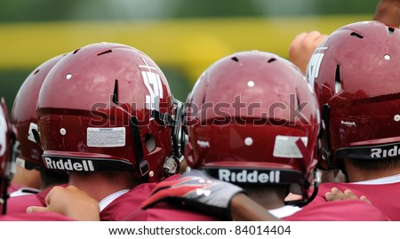 PLYMOUTH MEETING, PA - SEPTEMBER 3: St. Joe's Prep players huddle up just prior to kickoff against St. Marguerite D'Youville in a football game September 3, 2011 in Plymouth Meeting, PA - stock photo