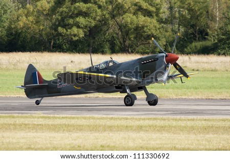 PLZEN, CZECH REPUBLIC - AUGUST 25: Fighter Spitfire XVI piloted by Stephen Stead in  Air Show at airfield in Plzen - Line, Czech Republic on August 25, 2012