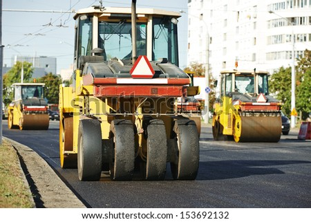 Pneumatic tyred roller compactor at asphalt pavement works for road repairing - stock photo
