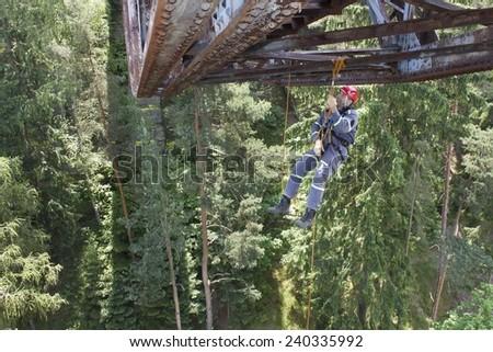 Pnovany, Czech Republic, June 4, 2014: Training elevation work on the old railway bridge over the dam Hracholusky, rescue work on the construction of the bridge - stock photo