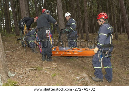Pnovany, Czech Republic, June 4, 2014: Training rescue of injured people in difficult terrain at the dam Hracholusky, carrying a stretcher with an injured person - stock photo