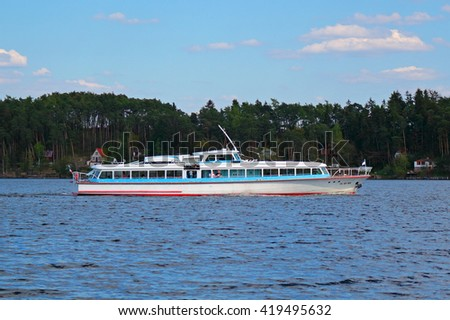 PNOVANY, CZECH REPUBLIC - MAY 7, 2015: Hydrobus ship Plzen on Hracholusky dam. Regular ship transportation on the lake and famous tourist attraction. - stock photo