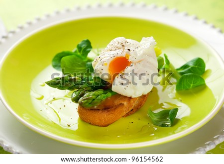 Poached egg and green asparagus on toast - stock photo