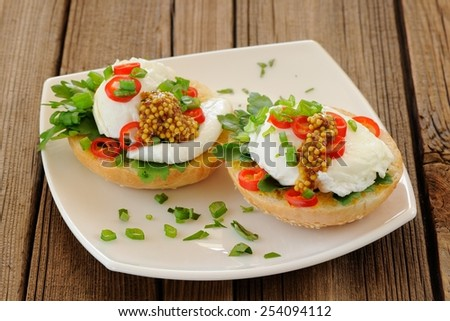 Poached egg sandwiches with chili and scallion - stock photo
