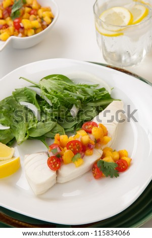 Poached halibut with peach salsa, and green salad.