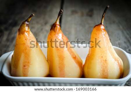Poached pears - stock photo