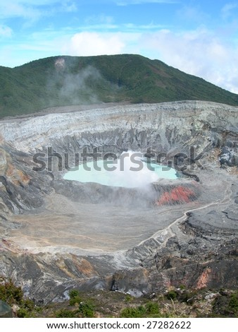 Poas Volcano Crater with misty sulfur clouds, in Costa Rica - stock photo