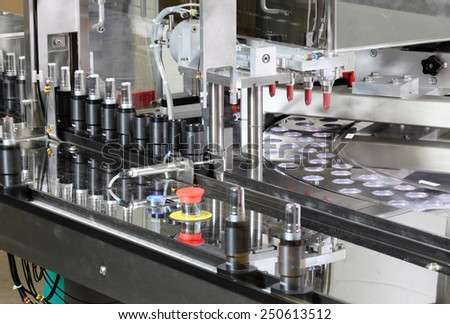 Pocatello, Idaho, USA  June 18, 2012 A machine putting lipstick in tubes in a cosmetics factory. - stock photo