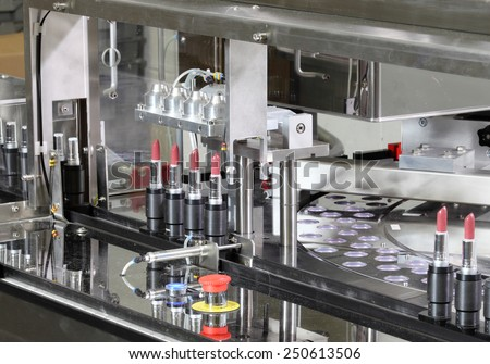 Pocatello, Idaho, USA  June 18, 2012 A machine putting listick in tubes in a cosmetics factory. - stock photo