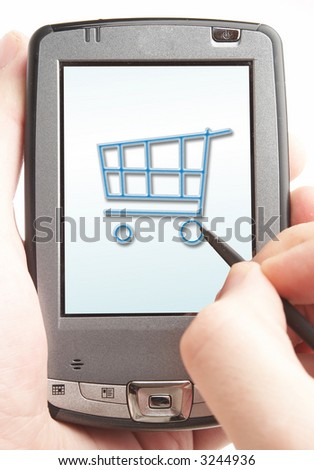 Pocket computer in a hand. Online shop.