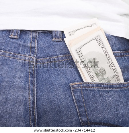 Pocket money.Young guy cleans the pocket money in jeans - stock photo