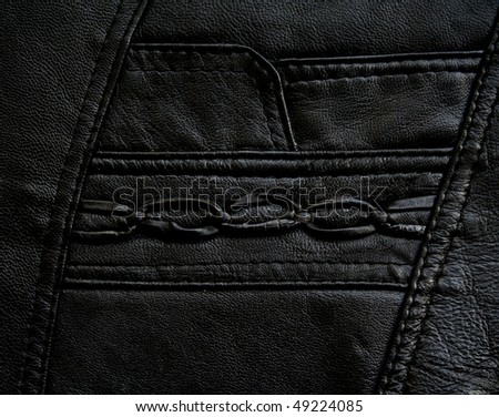 Pocket on the black leather texture as background - stock photo