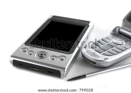 Pocket PC and mobile phone isolated over white background - stock photo