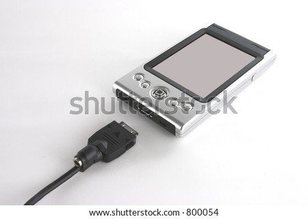 Pocket PC and sync cord isolated over white background - stock photo