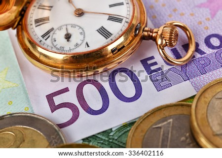 pocket watch and five hundred euro banknote, close up - stock photo