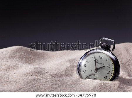 Pocket watch in sand