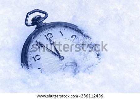 Pocket watch in snow, Happy New Year greeting card - stock photo