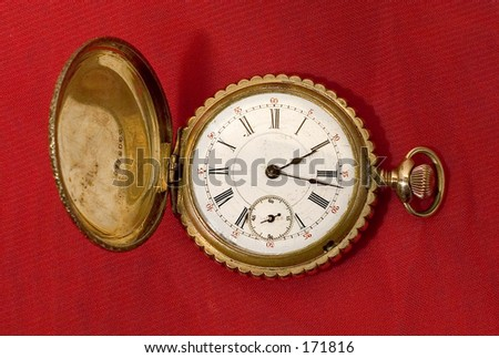 Pocket Watch on Red Background - stock photo