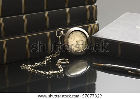 Pocket watch with books - stock photo