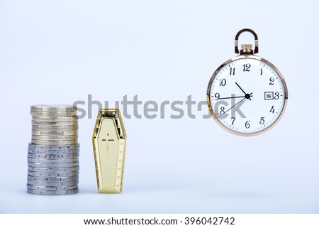 Pocket watch with European currencies and tomb in still life - stock photo