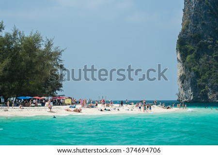 Poda Island thailand, January 21 2014 : Tourists enjoying the beautiful and wide poda Island beach surrounded by natural island beauty in Krabi province, Thailand