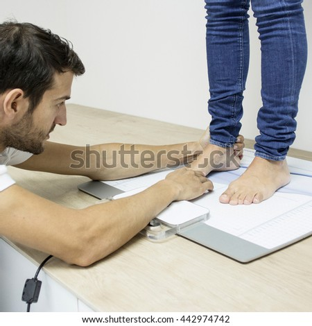 podiatrist working with foot - stock photo
