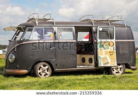 PODINGTON, UK - APRIL 11: A classic early vintage VW Camper van is parked on static display for members of the public to view during the Big Bang festival on April 11,2014 in Podington - stock photo