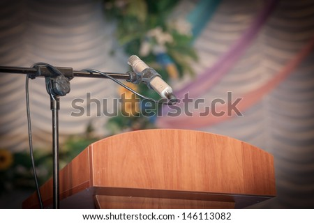 Podium with Microphone on a Stage  - stock photo