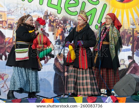 PODOLSK, OSTAFIEVO, RUSSIA - FEBRUARY 21: Unidentified women fights by stick on Russian religious and folk holiday Maslenitsa in estate Ostafievo on February 21, 2015, near Podolsk, Russia