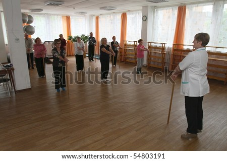 PODPOROZHYE, RUSSIA - JUNE 4: Day of Health in Center of social services for pensioners and the disabled Otrada (gymnastics with sticks for elders), June 4, 2010 in Podporozhye, Russia.
