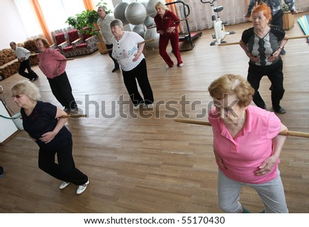 PODPOROZHYE, RUSSIA - JUNE 4: Day of Health in Center of social services for pensioners and the disabled Otrada (gymnastics with ball for elders), June 4, 2010 in Podporozhye, Russia. - stock photo