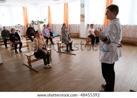 PODPOROZHYE, RUSSIA - MARCH 11: Day of Health in Center of social services for pensioners and the disabled Otrada (gymnastics with sticks for eldery), March 11, 2010 in Podporozhye, Russia.