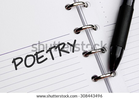 POETRY word written on notebook - stock photo