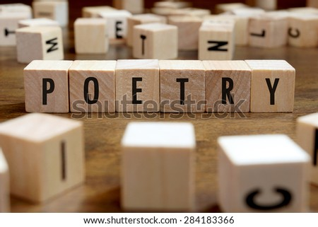 poetry word written on wood block - stock photo