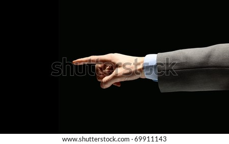 poiniting businessman hand, isolated on black - stock photo