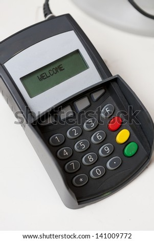 Point of sale credit card terminal used to process electronic payments at stores.