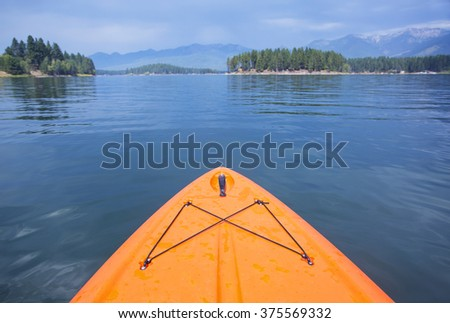 Point of view image of kayaking or paddle boarding on a beautiful Mountain. Wide angle view of nature's beauty