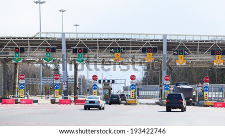 Point payment of travel on toll road with riding vehicles - stock photo
