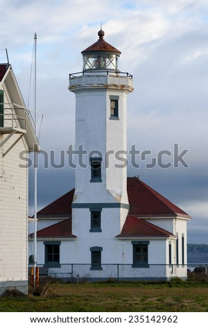 Point Wilson Lighthouse. Built in 1913 by the United States Lighthouse Service. At a height of 51 feet, the beacon is the tallest on Puget Sound, marking the entrance to Admiralty Inlet, Washington.