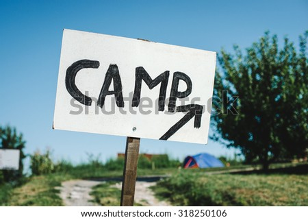 pointer and a sign with a camping tent,  - stock photo