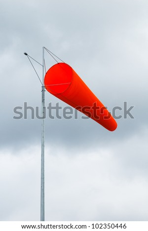pointer to the direction and strength of wind against the background of the sky - stock photo