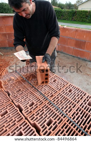 Pointing at building site. - stock photo