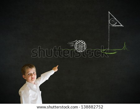Pointing boy dressed up as business man with chalk golf ball flag green on blackboard background - stock photo