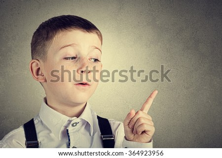 Pointing  little boy isolated over white background. - stock photo