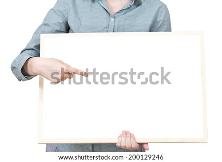 pointing on blank bulletin board in female hand isolated on white background