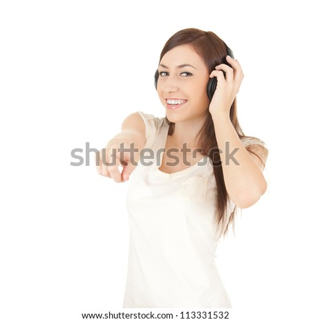 pointing on you young woman in headphones, white background - stock photo