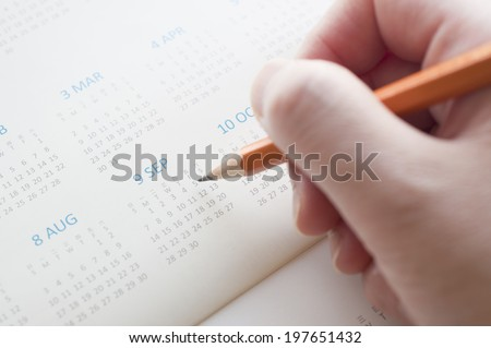 Pointing the date of calendar - stock photo